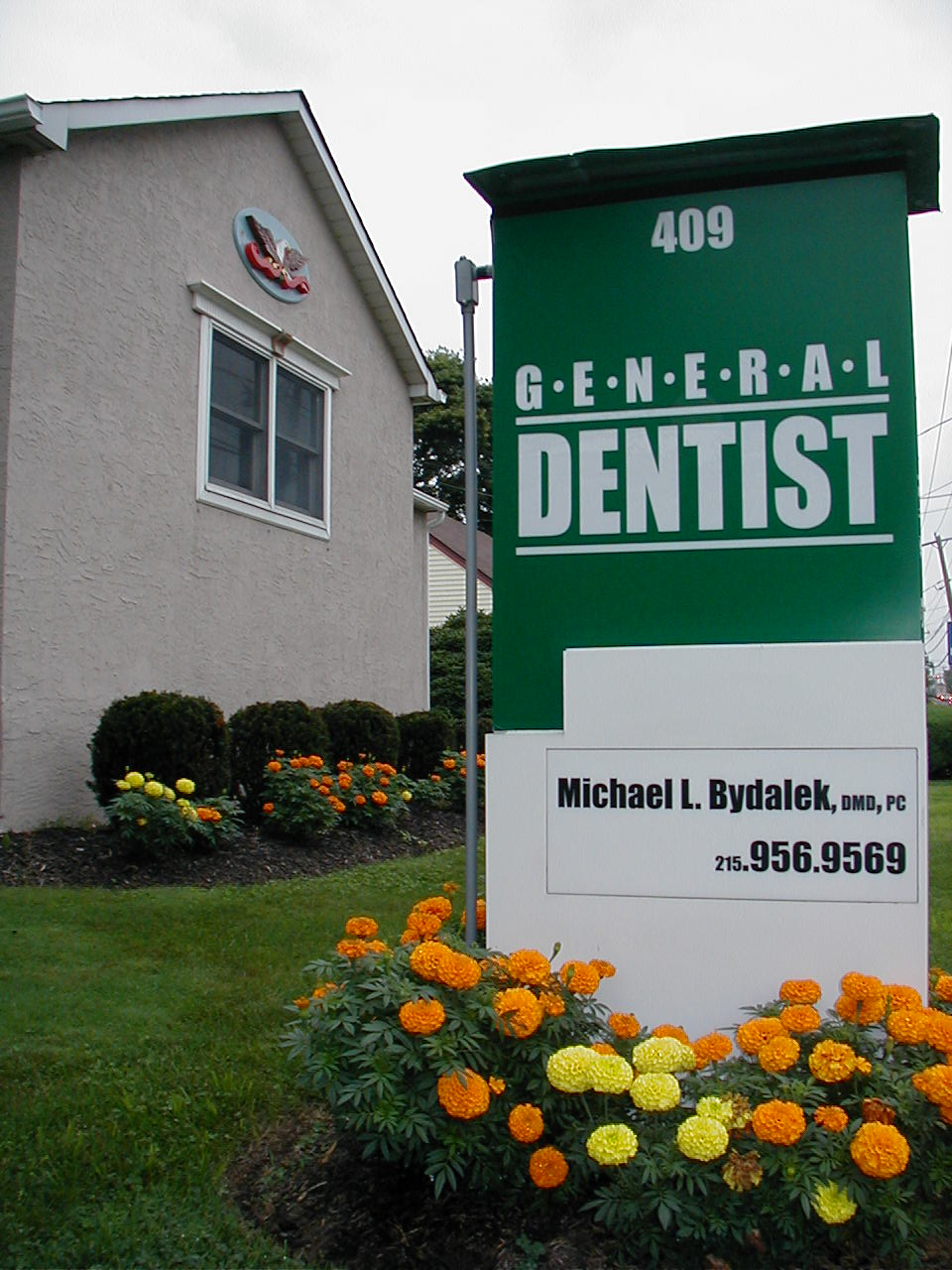 Front sign. Solo dental practice since 1990!